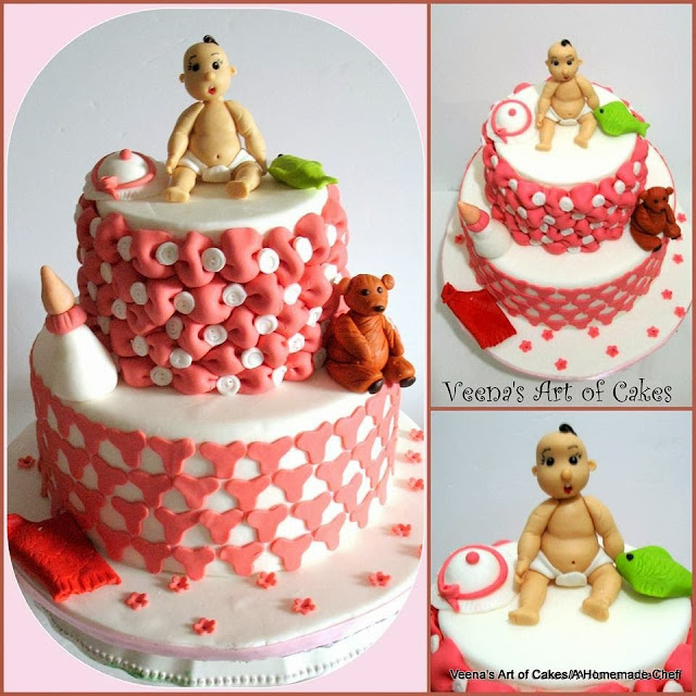 A decorated cake with a figure of a baby. made from gum paste on top.