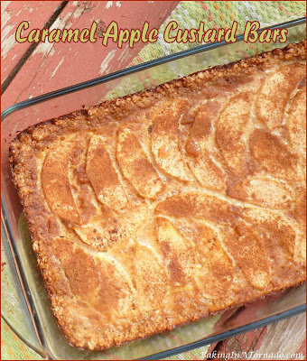 Caramel Apple Custard Bars feature and oat crust and a custard center with apples and caramel. The flavors of Fall in a dessert bar. | Recipe developed by www.BakingInATornado.com | #recipe #bake