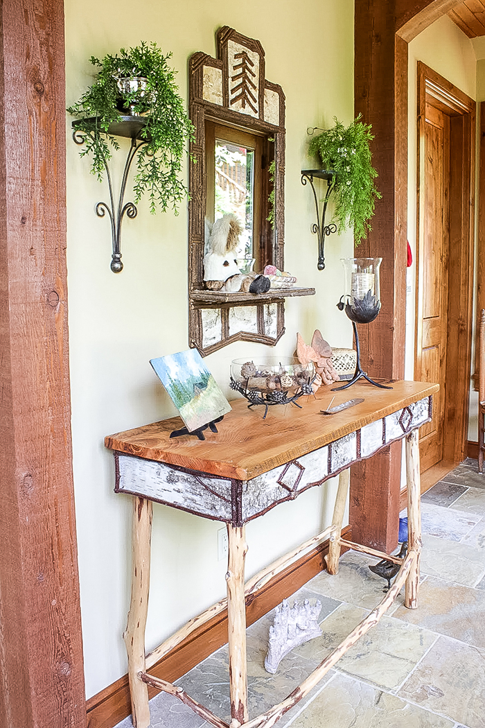 Rustic table with mirror above