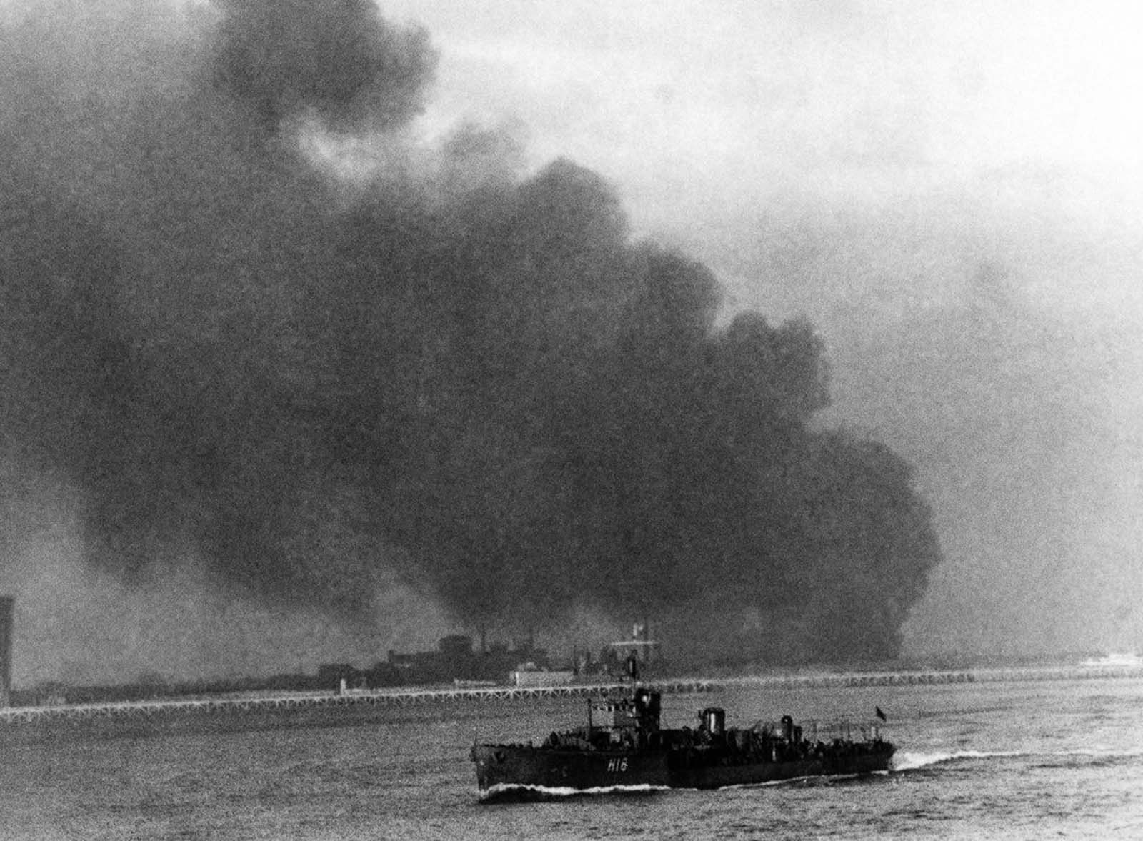 A British destroyer carries evacuees home while Dunkirk burns and the rearguard continues to fight.
