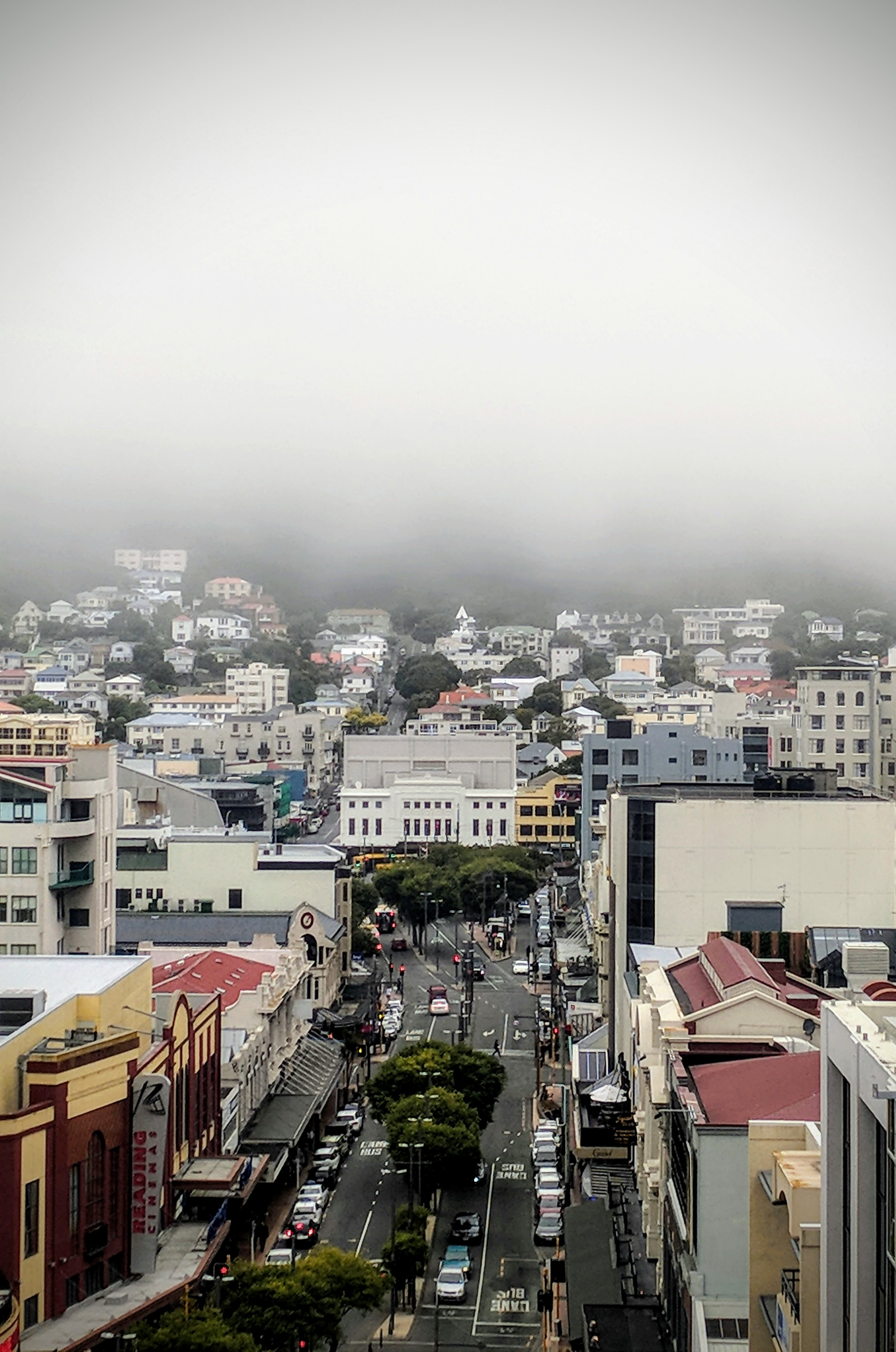 Low cloud hides Wellingtons Mt Vic as seen looking down and along Courtney Place