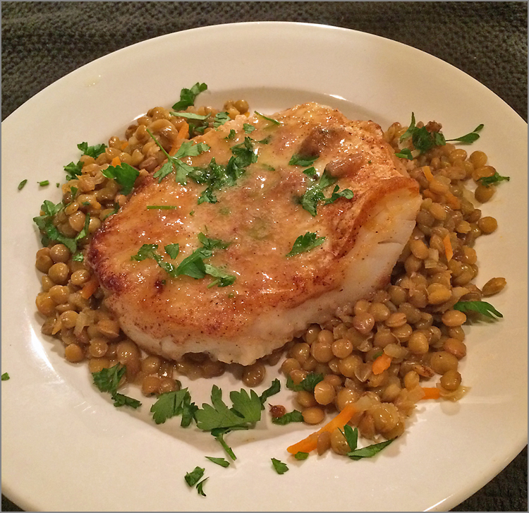 Sauteed cod with green lentils.