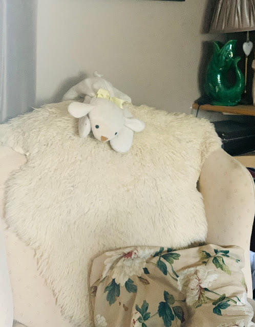armchair with toy lamb