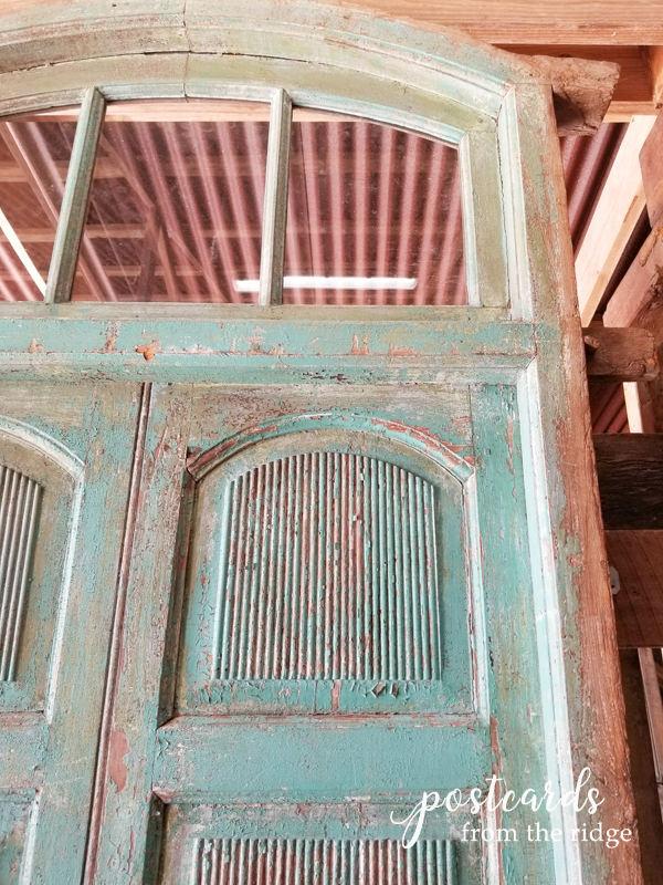 salvaged antique wooden doors with aqua paint