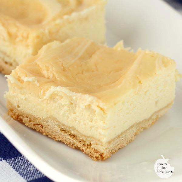 Creamy Lemon Swirl Cheesecake Bars | by Renee's Kitchen Adventures - easy dessert recipe for lemon cheesecake bars #RKArecipes #lemon