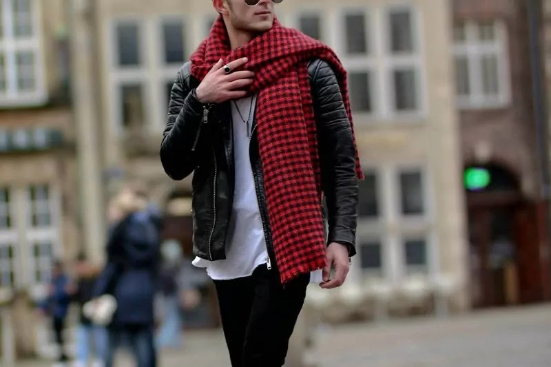 A men in red blanket scarf.