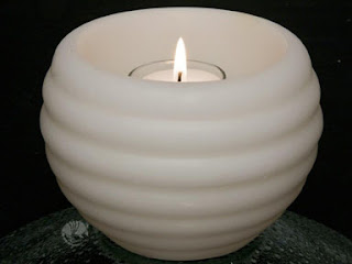 http://www.candlefactorystore.com/floating-pool-candles/