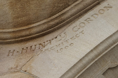 Photograph showing a carved detail: the name 'H Huntley Gordon, Architect'