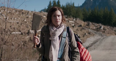 Allison Williams's character Charlotte holds a cleaver in the middle of nowhere in the Netflix horror movie The Perfection