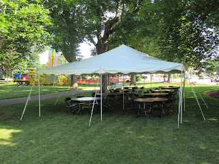 space to sit & eat under the tent on the Town Common