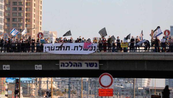 Multitudinaria marcha en Israel exige la renuncia de Netanyahu