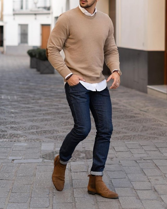 Man in Sweatshirt, jeans, shirts, jeans and Chelsea boots.
