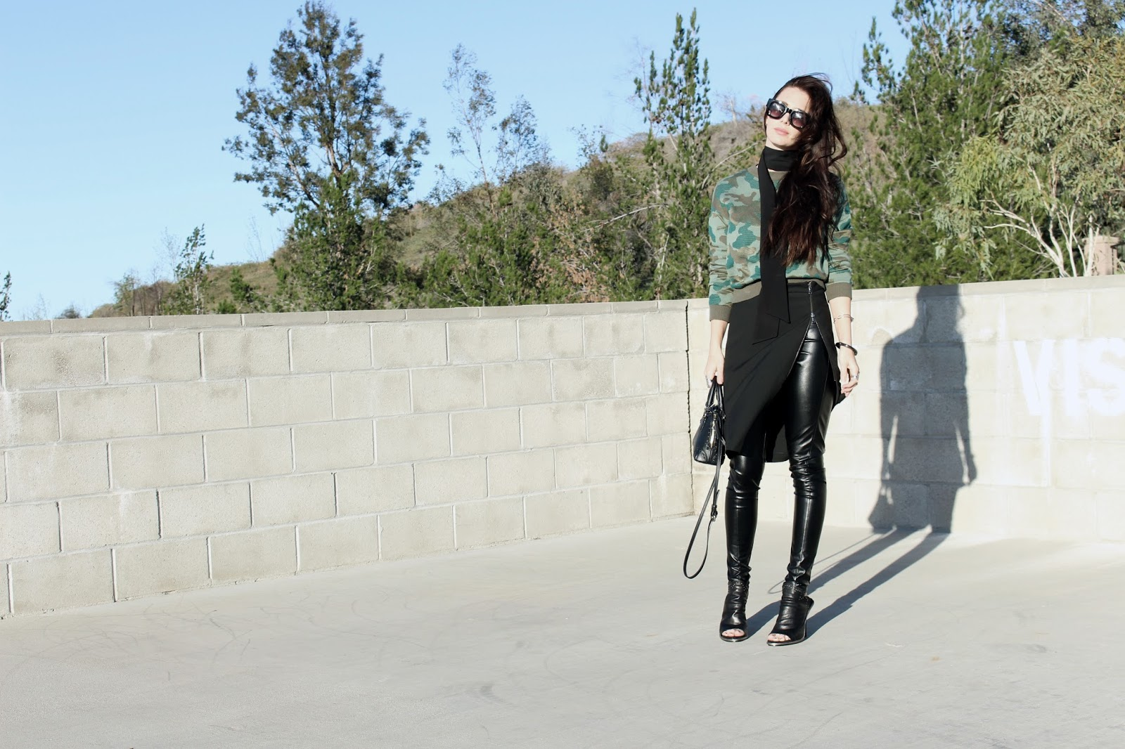 skirt over pants leather pants street style