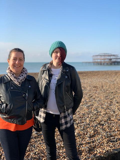 Women standing on Brighton beach