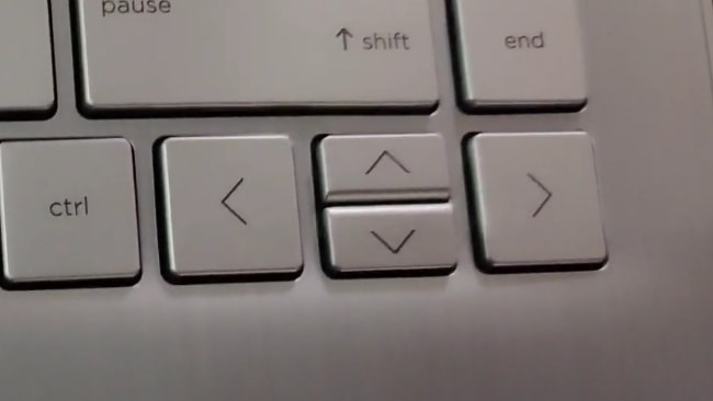 Small and very closely placed 2 arrow keys of HP 14s dr1009tu laptop.