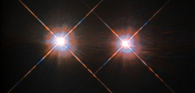 The Alpha Centauri group is the closest star - or solar - system outside of our own at a distance of 4.3 lightyears, and it can be found in the night sky in the constellation Centaurus. The stars Alpha Centauri A and Alpha Centauri B comprise a binary system, in which the two stars orbit one another, and close by is an additional faint red dwarf star, Alpha Centauri C, also called Proxima Centauri. Some astronomers have hoped to someday find an exoplanet capable of harboring advanced life in the system, but a new study lowers those expectations while raising them for the rest of the universe. Credit: NASA/ESA Hubble Space Telescope