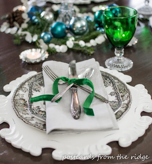 Holiday Tablescape Ideas using mostly vintage items. Love the velvet ribbon on the vintage silver.