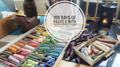 Image of a range of pastels on a studio table
