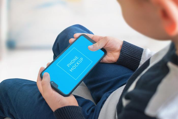 Boy Play Game Smart Phone Concept Smart Object Screen App Game Presentation Mockup