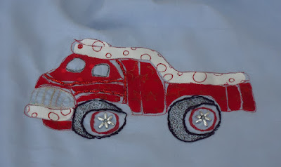 An embellished red dump truck