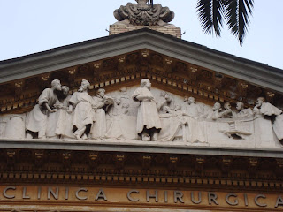 Gaetano Russo sculpted the figures in the pediment over the entrance to the Policlinico Umberto I in Rome