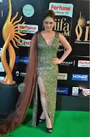 Nikesha Patel in Glittering Leg Split Deep Neck Green Gown at IIFA Utsavam Awards 2017     07.JPG