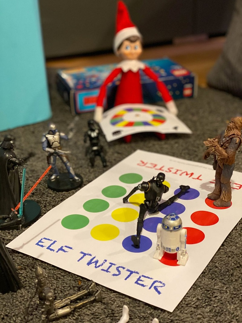 elf and toys playing twister