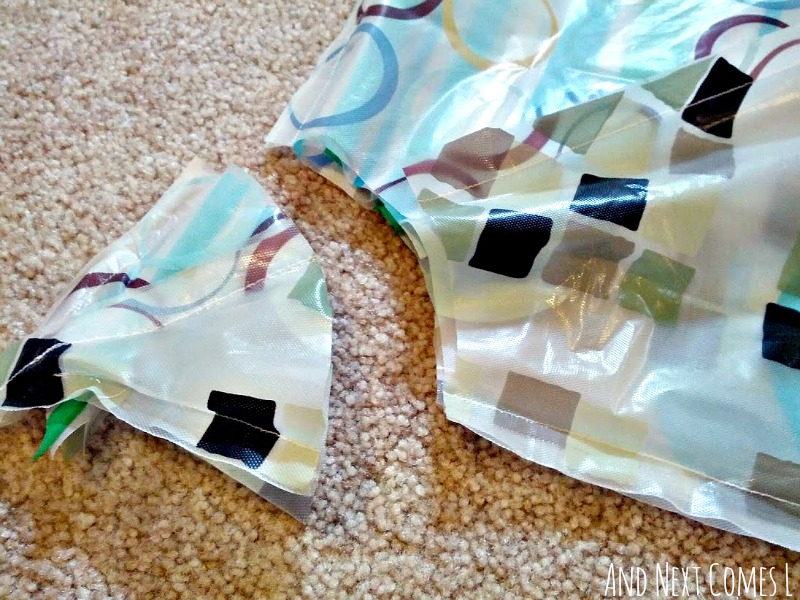 Photo tutorial for making your own homemade play parachute from dollar store shower curtains from And Next Comes L