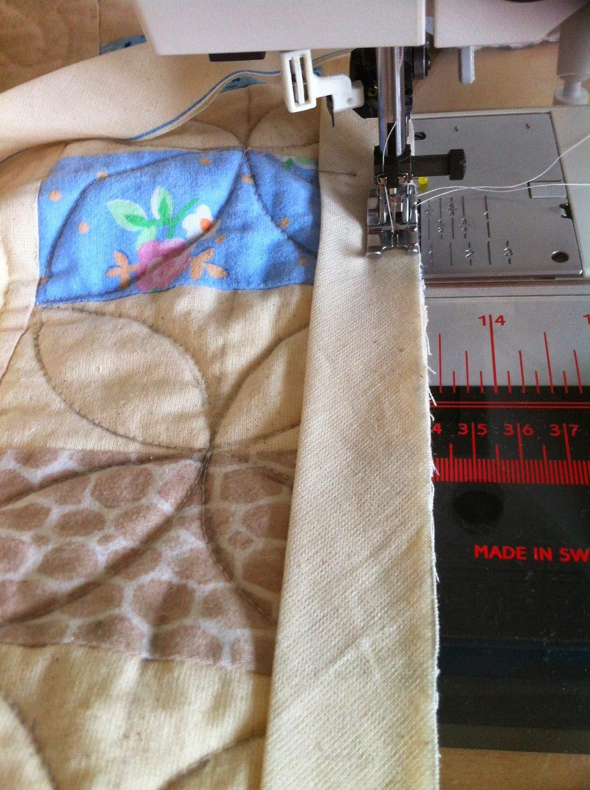 Afwerkbies aan quilt naaien