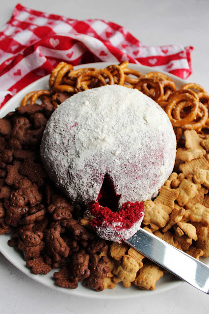 red velvet cheese ball with teddy grahams and petzels