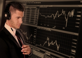 A man analyzing financial figures and graphs.