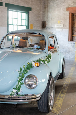 Classic Blue Volkswagen Beetle with flowers