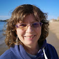 Headshot of Rachel Knowles author with sea in background(2021)