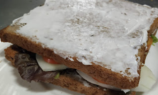 Vegetables topped bread slice cover with mayonnaise spread bread slice for veg club sandwich recipe
