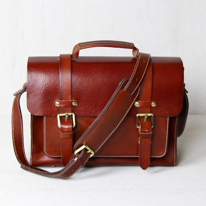 4032626d757e The understated elegance and subtle masculinity of this leather bag make it  a perfect personal accessory for any guy.