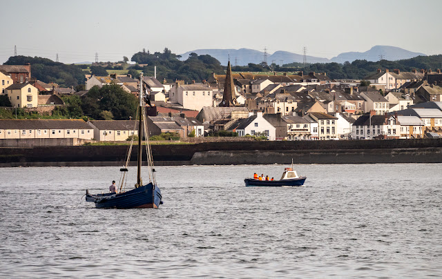 Photo of local boats out on the Solway Firth with Maryport in the background