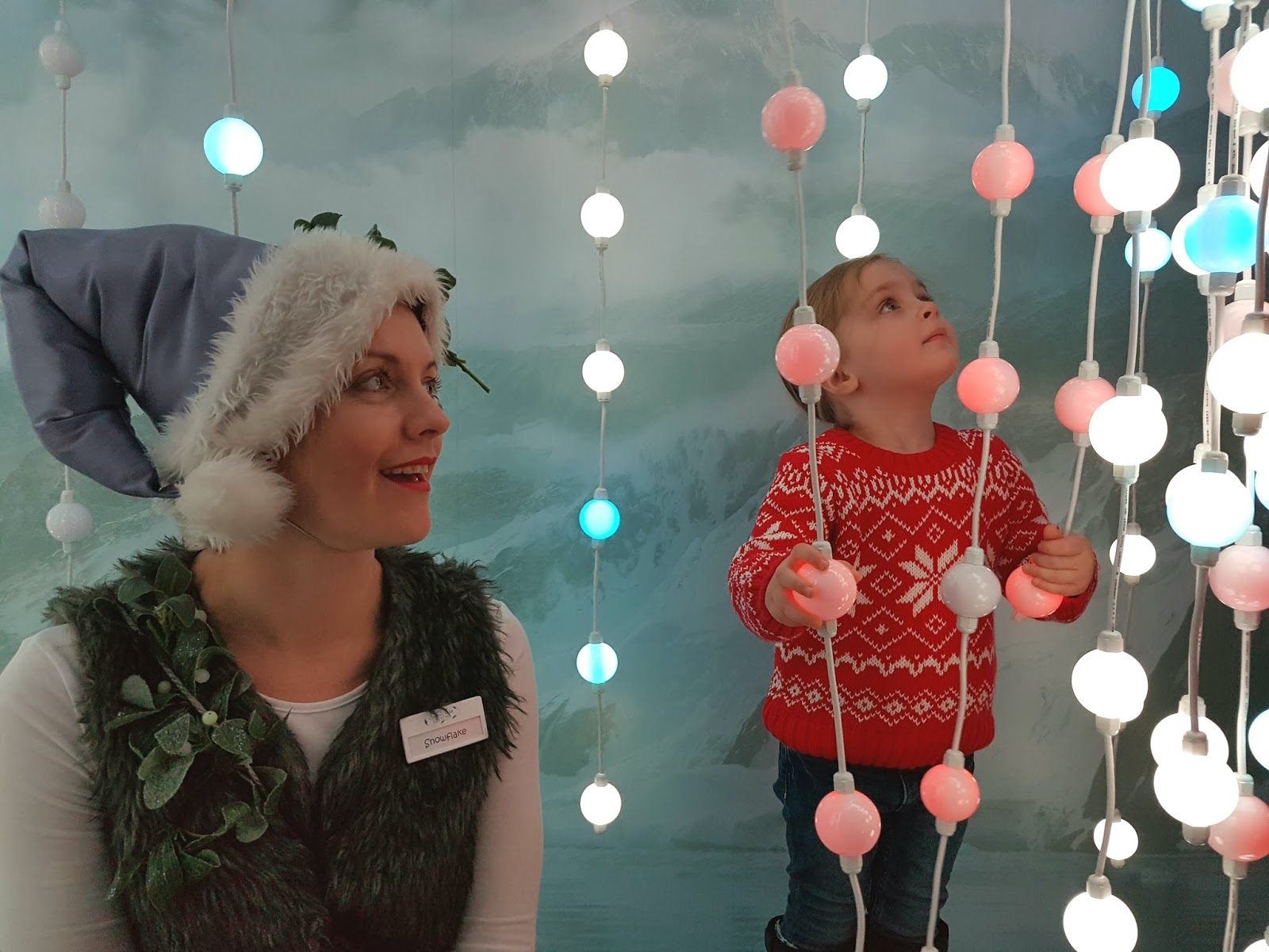 young girl and elf at christmas light forest at harrods christmas grotto 2016