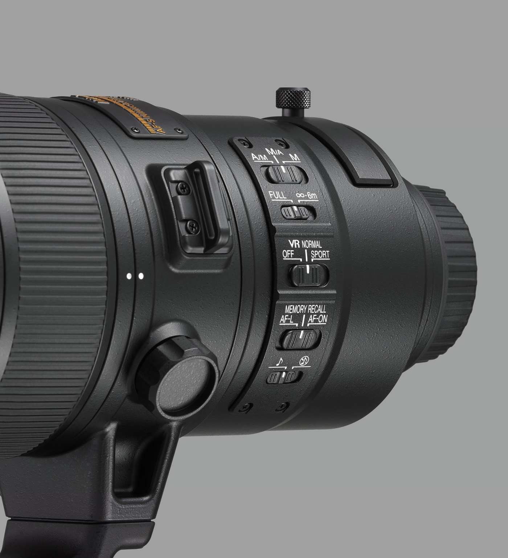 Переключатели режимов работы в объективе Nikon 180-400mm f/4