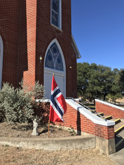 the Norwegian flag is displayed at the church as a sign of its history and heritage