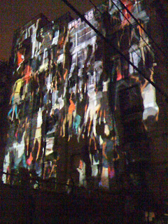 Projection of People Climbing Building