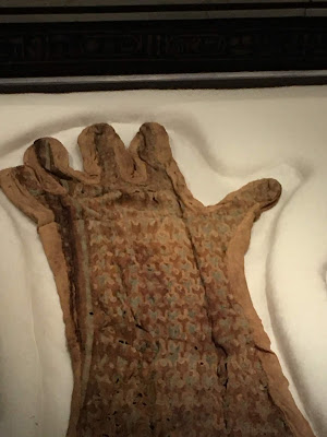 photo of faded embroidered glove