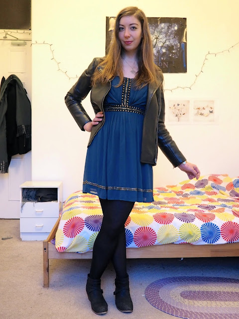 Merida inspired Disneybound outfit of short teal party dress with black leather jacket, tights and ankle boots