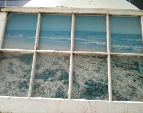 old window frame with fake ocean view