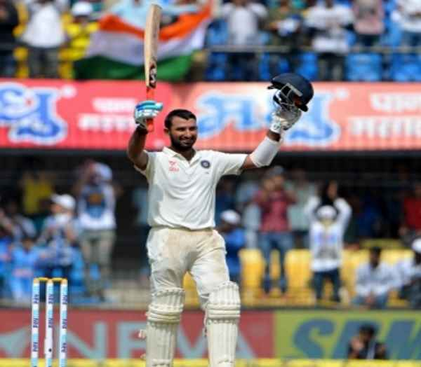 Pujara hits ton as India set Kiwis stiff target