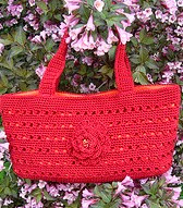 http://www.ravelry.com/patterns/library/bloomin-bag