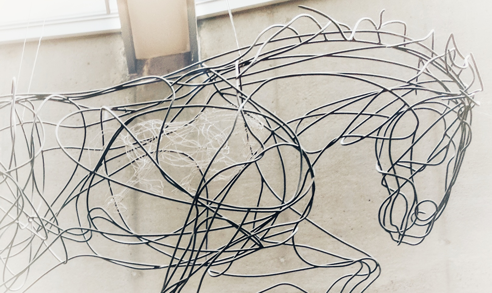Wire Horse sculpture with surprise in its middle