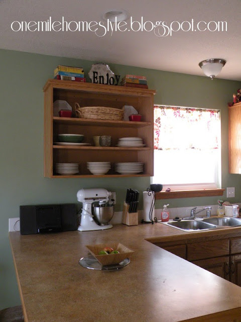Upper kitchen cabinet with doors removed