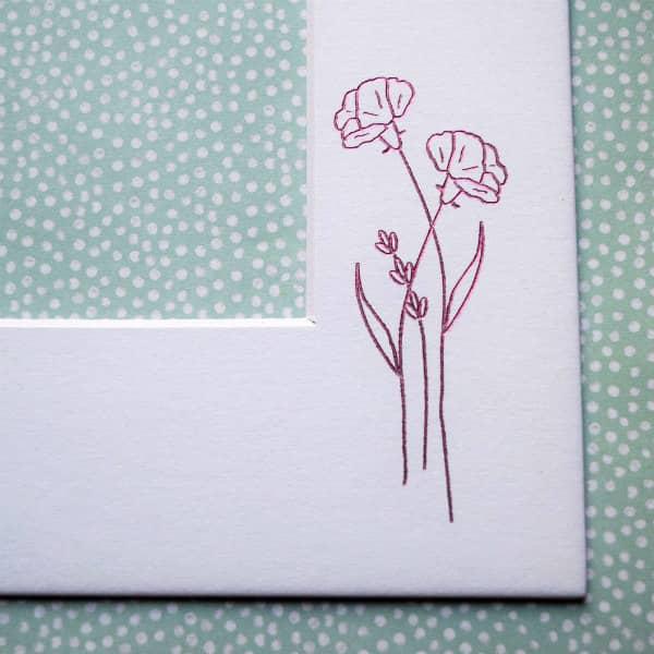purple foil transfer carnations on white photo frame mat