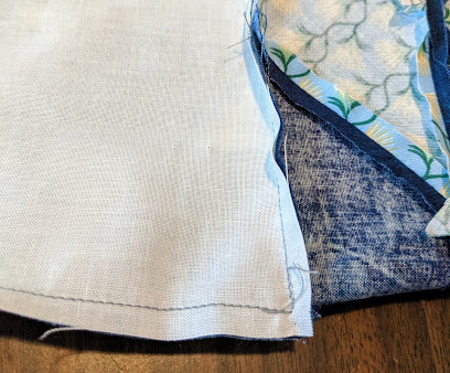 The background fabric is sewed to the Lone Star diamonds at backstitched when the intersecting seam allowance is reached