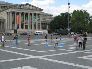Kids flying kites in Heroes' Square